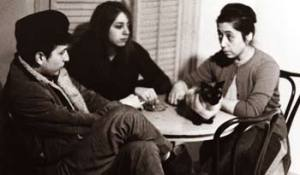 Bob Dylan, Suze Rotolo and Lena Spencer sit at a table in Caffe Lena. The photo was taken in 1961 by Joe Alper.