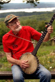 Pete Seeger's still singing and strumming at age 89